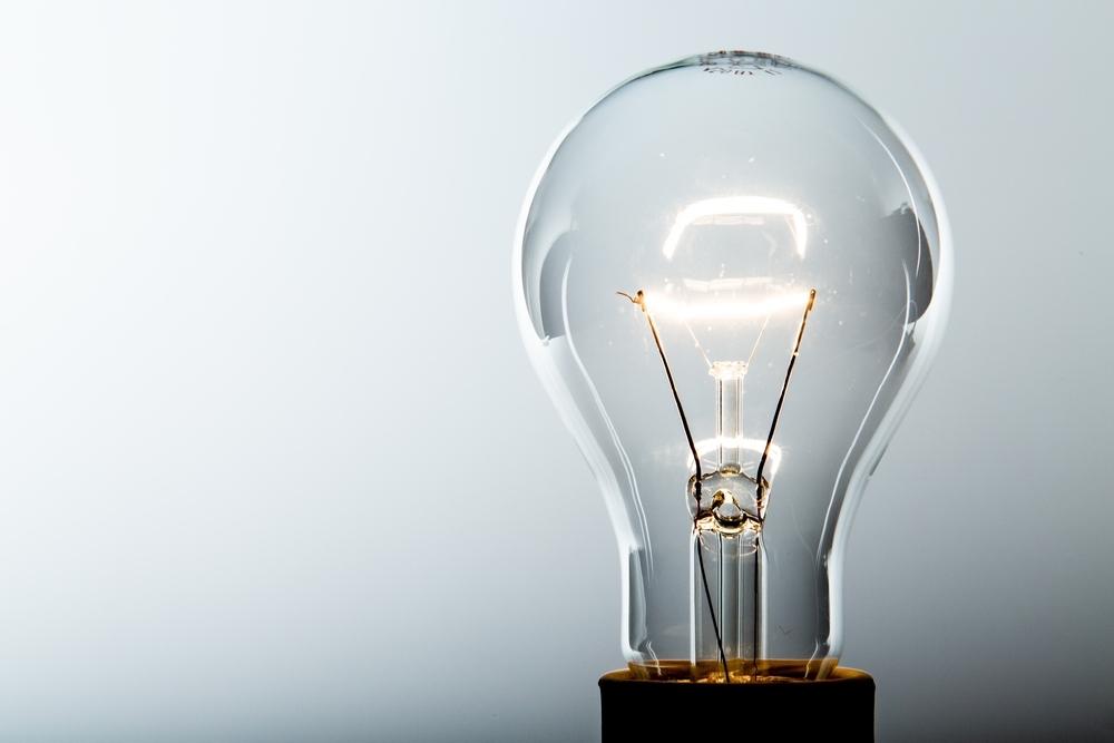 illuminated lightbulb indicating ideas to advance career during downturn