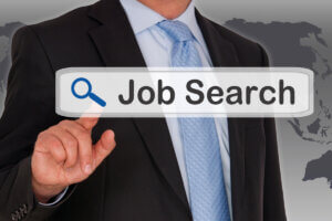 man in business suit clicking job search button