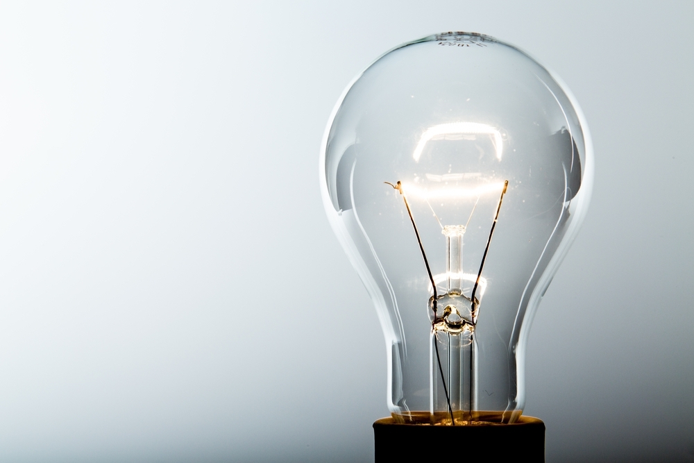 illuminated lightbulb indicating ideas to advance career during downturn